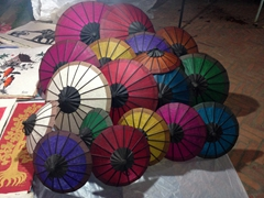 Colorful paper umbrellas for sale at the night market; Luang Prabang