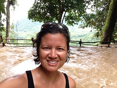 After a hard hike, Becky makes it to the top of Kuang Si Waterfall in the rainy season