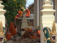 Monks working on Wat That Luang Tai