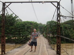 Robby crossing the toll bridge (4000 kip for pedestrians, 6000 kip for bikes and 10000 kip for motorcycles); Vang Vieng