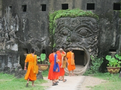 Monks willingly entering the mouth of a beast; Buddha Park