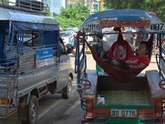 Taking a nap in his Jumbo tuk tuk; Vientiane
