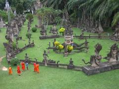 Orange clad monks enjoying their visit to Buddha Park
