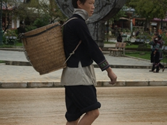 Most men wear modern clothing but this young man was dressed in his traditional best; Sapa