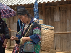 This Black Hmong lady was constantly twirling and twisting strands of hemp