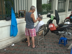 Street side barber services; Hanoi