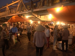 Hustle and bustle under the Long Bien Bridge