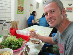 Robby enjoying bun cha at Bun Cha Dac Kim, one of the best restaurants to sample this Hanoi dish