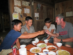 Robby drinking rice wine with Su, Vung and Vung's son; Ta Phin homestay