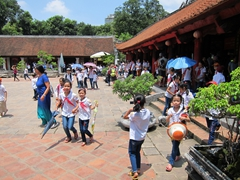 Excited school kids emerge from a long lecture at the Temple of Literature; Hanoi