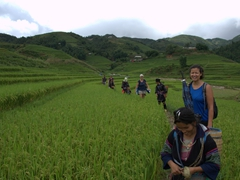 Enjoying our Sapa trek through rice paddies