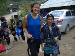 "Becky buys a purse from this Black Hmong woman who ""claimed"" Becky as hers at the very beginning of the trek!"