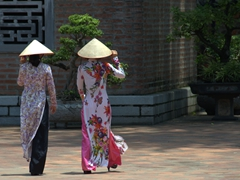 "Ladies wearing traditional ""ao dai"" dresses; Temple of Literature"