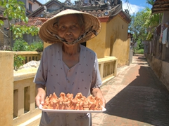 Old lady selling clay figurines; Thanh Ha Terracotta Village