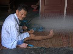 Mending a net; Thanh Ha Terracotta Village