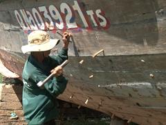 Worker at the Cam Kim Island shipyard