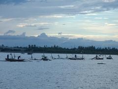 Going through their fishing nets at sunset; Cua Dai Fishing village