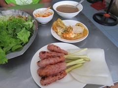 "Homemade ""nem lui"" (minced pork rolls on a lemongrass stick) and ""banh khoai"" (rice pancake stuffed with pork and shrimp) at the excellent Hanh Restaurant in Hue"