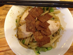 Cao lầu - a regional dish of noodles, pork and greens found only in Hoi An