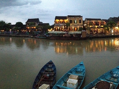 Panorama of Hoi An's riverfront during a rain storm