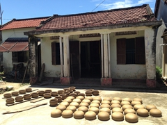 Clay pots drying in the hot sun; Thanh Ha Terracotta Village