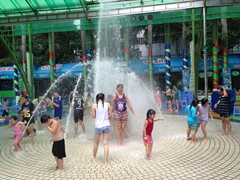 Becky getting blasted at Dam Sen waterpark; Saigon