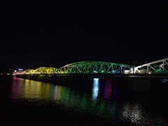 Artistic lighting at the Truong Tien bridge at night in Hue