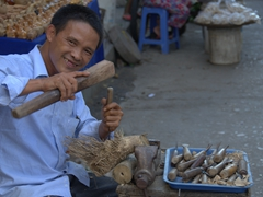 Toothless grin on a woodcarver; Hoi An