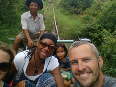 Tig, Denise and Robby pick up a little hitchhiker on the bamboo train!