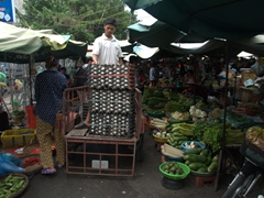 Unloading crates of eggs at the old market in Phnom Penh