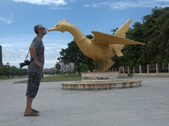 Robby kissing a golden Garuda statue at Wat Botum Park
