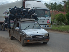 An overloaded pickup truck transporting coal; Battambang