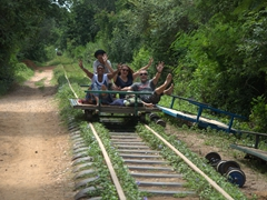 The gang comes screaming to a stop on the Battambang bamboo train - well worth a visit to this part of Cambodia for this ride alone!