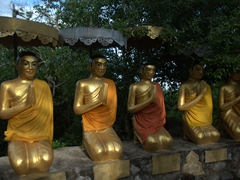 A row of Buddhas hopefully brings peace to the tortured souls at the Phnom Sampeau killing caves
