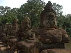 View of some of the 54 stone demons (half of the mythical beings guarding the city of Angkor Thom)