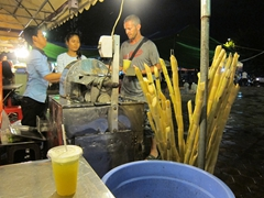 Getting fresh sugarcane juice for 2000 Riel (50 cents) at the night market