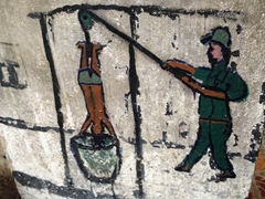 Crude painting showing one of the many execution methods employed at the killing caves of Phnom Sampeau