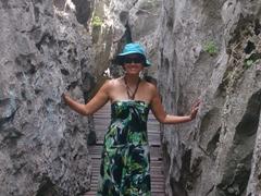 Becky in a volcanic crevice; Ko Mae Ko