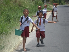 Excited school kids reach out for a high five on our drive around Samosir Island