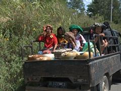 Batak women crowded in a pickup truck; Samosir Island