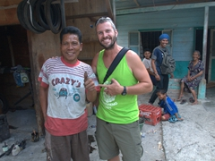 Crazy's tire repair shop - Robby is all smiles after getting charged less than $1 to fix our flat tire; Samosir Island