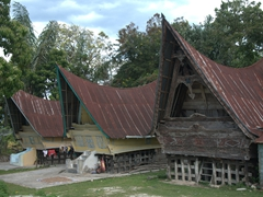 Another example of Batak Toba traditional houses with their famous boat-shaped roofs and finely-decorated carvings