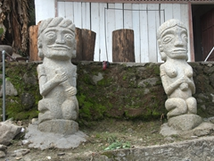 Volcanic statues outside a Batak house was quite a common sight in Ambarita; Samosir Island