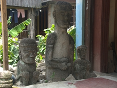 Statues outside a house in Tuk Tuk Village; Samosir Island