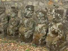 Volcanic statues stand guard at King Sidabutar's Grave; Tomok