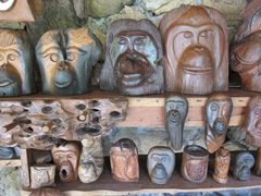 Driftwood orangutan masks for sale; Bukit Lawang