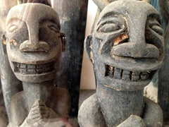 Wooden figurines on display at Museum Huta Bolon Simanindo