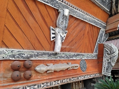 Symbolic carvings above the entranceway to a Batak dwelling; Huta Siallagan