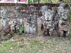 Statues in the graveyard of King Sidabutar; Tomok