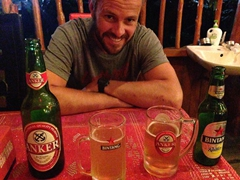 Robby smiling over our Anker and Bintang beer; Jenny's Restaurant